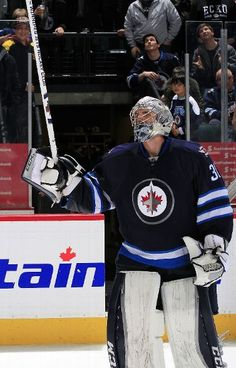WINNIPEG, MB - DECEMBER 27: Goaltender Connor Hellebuyck #30 of the Winnipeg Jets salutes the fans after recording his first career NHL shutout in a 1-0 victory over the Pittsburgh Penguins at the MTS Centre on December 27, 2015 in Winnipeg, Manitoba, Canada. (Photo by Darcy Finley/NHLI via Getty Images)