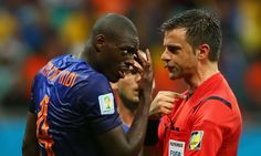 Referee Nicola Rizzoli talks with Bruno Martins Indi after the Costa incident