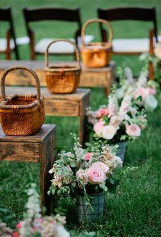 Wooden bench seating with flowers lining the aisle. Found on Southern Weddings Mag. # weddingseating #benches