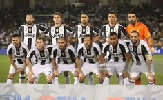 Juventus FC team poses for the group photo during match between Juventus FC and AC Milan at the Jassim Bin Hamad Stadium on December 23, 2016 in Doha, Qatar.