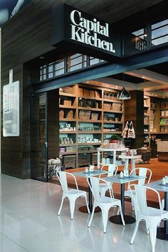 """Located on the outskirts of Melbourne, Capital Kitchen features a combination of rustic and industrial elements—with a few modern touches throughout. Designed by Australia-based Mim Design (""""We were going for a modern country farmhouse feel,"""" the designers say), the interiors feature rustic timber floors, exposed brick walls, and sleek modern Carrara counters. For more information, go to Capital Kitchen.."""