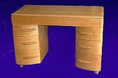 used to have a bunch of Heywood Wakefield pices - including this desk, Kitchen table, china cabinet, end tables, coffee tables and a complete reproduction bedroom set.  I'll redo my kitchen in it one day....