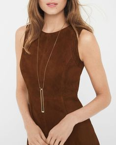 """Complement your Fall wardrobe of rich suede and buttery leather looks with this snake-embossed leather pendant necklace. The mix of textures make for a luxurious end result.  Leather pendant necklace.  Approx. 34"""" in length with 2"""" extender. Lobster close; goldtone; leather. Custom designed exclusively for WHBM. Handcrafted with nickel-free and lead-free metal."""