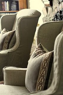 Linen slipcovers with simple trimmed accent cushions... great layers of texture, subtle colors... earthy, warm, understated