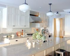 River White Granite Countertops & white glass titled walls with white grout