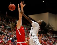 Stanford Cardinal's Lili Thompson (1) takes a shot against Cal State Northridge Matadors' Camille Mahlknecht (4) in the second half of their 2015 NCAA Division I Women's Basketball Championship first round game at Maples Pavilion in Stanford, Calif., on Saturday, March 21, 2015.  (Nhat V. Meyer/Bay Area News Group)