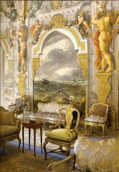 This image identifies influences from both the Renaissance style of design of the mid 14th century - 16th century as well as the Rococo period of the 18th century. The Renaissance period of design was a return to Ancient Greece and Rome and included the re-emergence of classical features such as columns, cornices and pediments. In this room these elaborate and decorative characteristics are presented through the symmetrical scenic murals on the walls rather than in carvings and plasterwork…