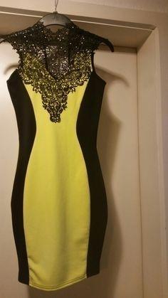 Sehr schönes Kleid in gelb schwarz