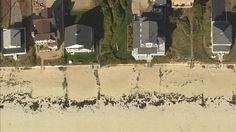 """Sandy strip near Ogunquit River, Maine. This is the beach that experience the 1991 storm later deemed """"The Perfect Storm"""" [From Aerial America: Maine]"""