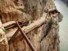 El Caminito del Rey in Spain (The king's little pathway) - This trail was built to access a dam at the beginning of the 20th century.  At it opening the king of Spain walked it, which is why it is know as the king's pathway.  The trail has unfortunately fallen into disrepair explaining the poor state and dangerous conditions found along the way.