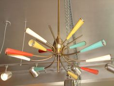 View this item and discover similar for sale at - 12 light atomic brass chandelier with red, aqua, yellow and white enameled bobeches. Italian Chandelier, Brass Chandelier, Chandeliers, I Love Lamp, Mid Century Modern Lighting, White Enamel, Ceiling Fan, Mid-century Modern, Aqua