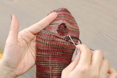 Cookie A shows the same way to repair holes in socks  http://cookiea.com/news/2012/07/repairing-socks/#