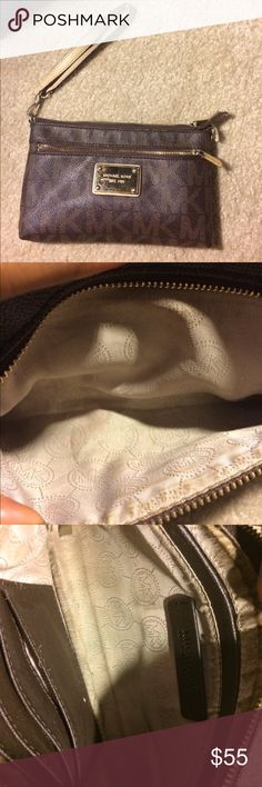 Michael Kors leather wristlet Used Michael Kors leather wristlet. Original loop hole for handle whipped so it has been placed in the opposite side as shown in pictures. Still has a lot of life left Michael Kors Bags Clutches & Wristlets