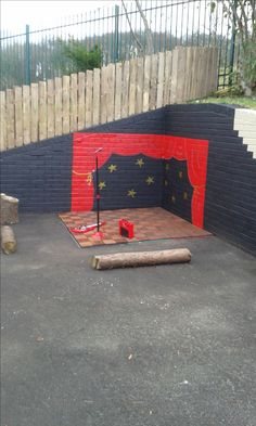 Dramatic play area outside, in closed by two walls. Change the paint every once and a while creating a new scene for the children. Bring Dramatic play outside! Pout outdoor carpet over the dead garden? Eyfs Outdoor Area, Outdoor Stage, Outdoor Play Areas, Outdoor School, Outdoor Theatre, Play Area Outside, Kids Play Area, Outdoor Toys For Girls, Playground Painting