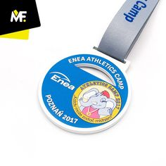 Sport medal for ENEA ATHLETICS CAMP Poznań 2017.  Metal medal, painted white, unilateral medal, transparent with dedicated textured graphics spatially decorated with a color-matched ribbon  #sportevent #athletes #medals #awards #children