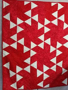 Quilts Beyond Borders:  red and white quilt 2015.  If you focus on the red parts you will see that this is a twisted pinwheel quilt.