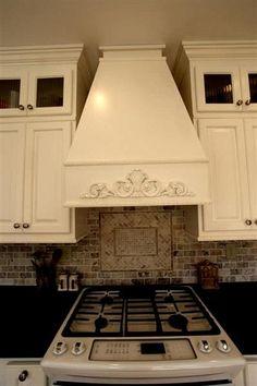 This Kitchen Remodel Includes A Custom Hood Stove, Custom Tile Backsplash,  And A Darker