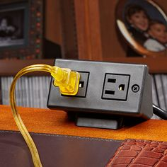 Dual Outlet Power Dock -$36.95- Make access to your outlets more convenient Our unique and clever Dual Outlet Power Dock moves low and inconvenient electrical outlets to a spot where you can easily reach them—without re-wiring! Originally designed for hotels, to bring outlets up from behind nightstands and beds, they provide an easy and attractive way to transfer the electrical outlet from the floor to your table. We use them here at Sporty's on our desks.