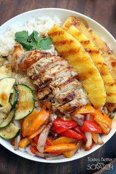 Hawaiian chicken veggie bowl: chicken, white sticky rice, zucchini, mixed peppers & pineapple