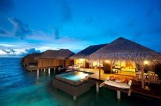 Lina Point Belize                                              Overwater bungalows you can buy!!               Yes please!!!