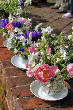 nice variety of mixed flowers in teacups.
