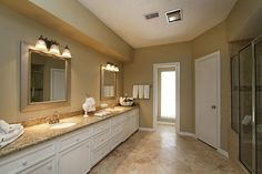 Master bathroom with granite countertops and shower room.
