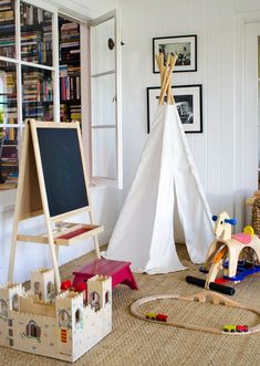 bright white playroom- looks great with sisal rug and b+w photos