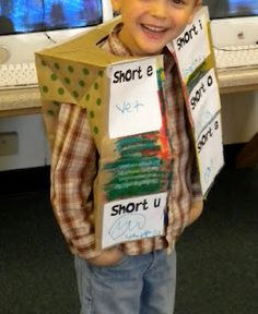 Using paper grocery bags, students can make short vowel vests! They write a word and draw a picture for each short vowel sound, glue it on, and wear it proudly! Crazy cute.