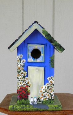 Outdoor Bird House, Handcrafted and Hand Painted, Yard or Home Decoration Painted Blue with lots of Flowers and a Car in the Garage. $79.00, via Etsy.