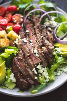 Perfectly seasoned grilled steak, homemade blue cheese dressing AND croutons, plus red onion, avocado, and tomatoes take this black n' blue grilled steak salad to a whole new level of delicious.  You guys. This is the salad of my dreams. And the salad of your dreams, you just didn't know it until right this minute. …