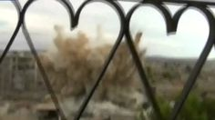 Huge explosions as helicopter drops bombs over Darayya