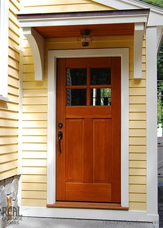 Quaint side entry door customized to suit this beautiful home.