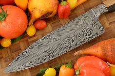 Chef's Knife (8.5 in.) with Feather Damascus and Black and White Ebony