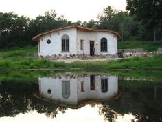 These people (claysandstraw.com) build beautiful natural cob houses in Central Texas! One of these days...