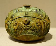 A newer style of gourd Colligen is creating replicate, with stunning accuracy, the look of ancient ritual vessels from China.