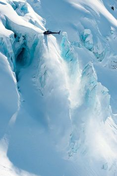 This looks like it's straight out of a James Bond movie! Helicopter landing in Cordova, Alaska. Photo by Court Leve