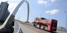 A sightseeing bus crosses the Clyde Arc, Glasgow