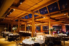 {Winter wedding at Bridgeport Art Center Skyline Loft in Chicago. Elevated, garden-style centerpieces and low centerpieces. King's table with garland and candles.} Flowers by Pollen, pollenfloraldesign.com ||  Photography by Tim Tab Studios, timtabstudios.com