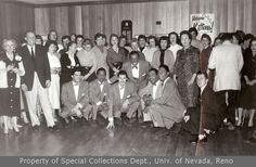 A large group of unidentified women and several African-American men (1957)