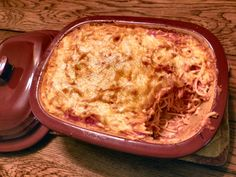 Deep Covered Baker Spaghetti Casserole  1lb ground beef, browned   1 pkg spaghetti noodles, cooked  1 26oz jar of spaghetti sauce   1 14.5oz can of diced tomatoes  1 can cream of mushroom soup  1 8oz cont sour cream  1 sm onion cook with meat.  2 Cups shredded Colby/Jack cheese  Mix spaghetti sauce w/ tomato sauce, add soup and sour cream to cooled meat. Layer noodles, sauce, meat, cheese until baker is filled, cover, bake @375 1hr.  www.pamperedchef.biz/sues2010