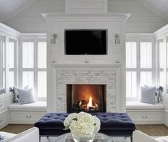 White fireplace with windows on all sides. Amazing!
