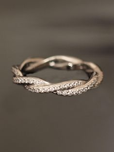 Double Twist Eternity Band. So pretty. Maybe for 10 year anniversary?