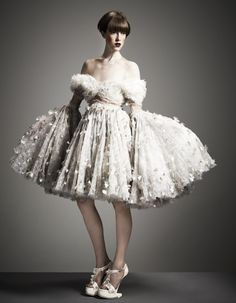 Dandelion-embroidered tulle dress with trumpet sleeves, and matching suede Horseshoe sandals. Alexander McQueen.