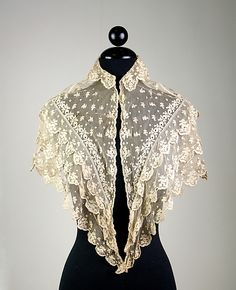 Pelerine Irish ca. 1830-1840.  Pelerines were used as a semi-decorative shoulder covering. Similar to a capelet they could be made in a variety of materials. The pelerine sometime matched the dress. This piece is very specific to this decade. It lost popularity in the early/mid 50's.