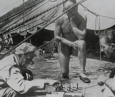 1940s Men Circus Performers Playing Chess Shirtless Shorts Clown Outdoors