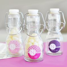 Our MOD Pattern Monogram Mini Glass Bottle Wedding Favors will be the talk of your event when you fill them up with your favorite candy and decorate them with your very own personalized label! Perfect for holding small treats like jelly beans, mints, gum and much more, these hinged-lid glass bottle favors will be a lifelong keepsake for guests. They can use their personalized candy jar to hold small items around the house and always remember your big day when they glance at the colorful…
