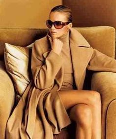 Beige cashmere coat w/turtleneck dress and sunnies...a class act.