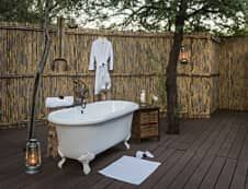 A game farm in the Great Karoo with a truly African outdoor bathroom experience at Mount Camdeboo South African Decor, South African Design, Safari Bathroom, Game Reserve South Africa, Game Lodge, Private Games, Outdoor Bathrooms, Black And White Tiles, Brown Furniture