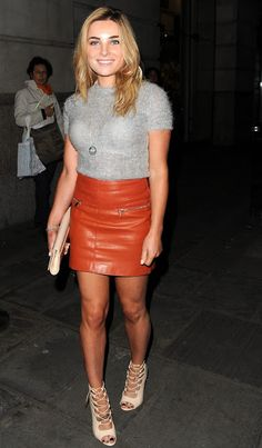 Celebrities In Leather: Sian Welby wears a red leather skirt