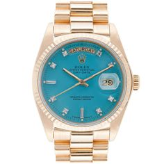 I am not a watch person but if i was this would be on my wish list....turquoise rolex..